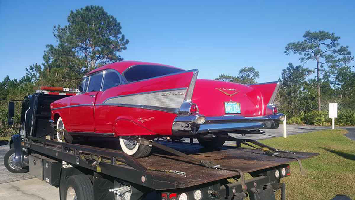 Classic Car on flatbed tow truck