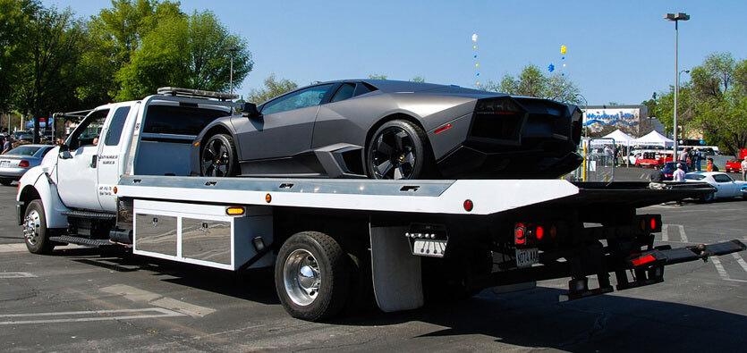 exotic sports car on flatbed tow truck toronto