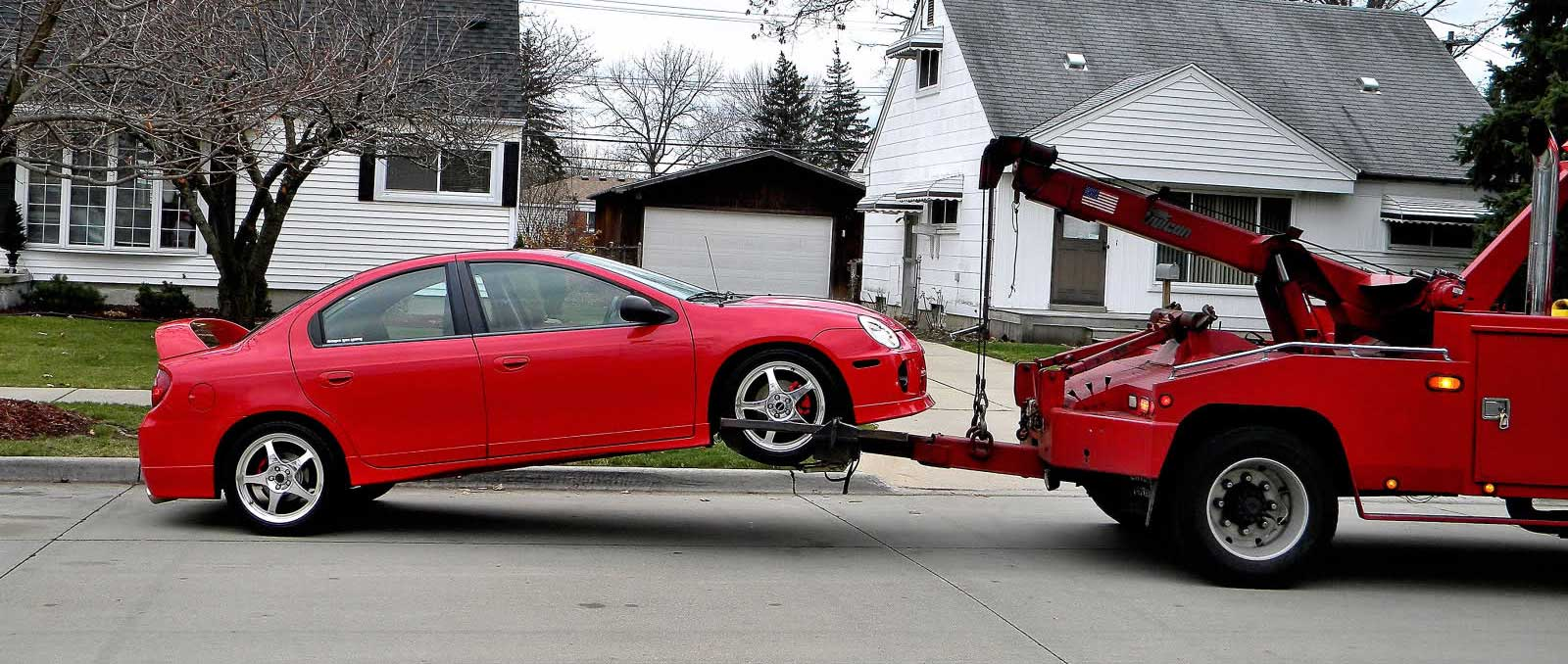 Cheap Two Wheel Tow with Red Car
